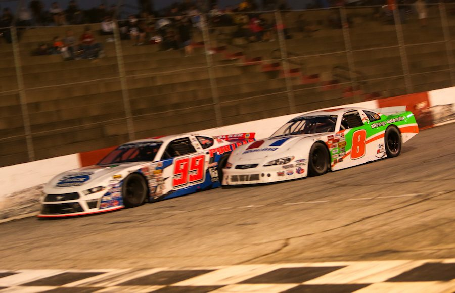Josh Berry (8) drives under Layne Riggs for the race lead during the Old North State Nationals for the Solid Rock Carriers CARS Tour at South Carolina's Greenville-Pickens Speedway. (Adam Fenwick Photo)