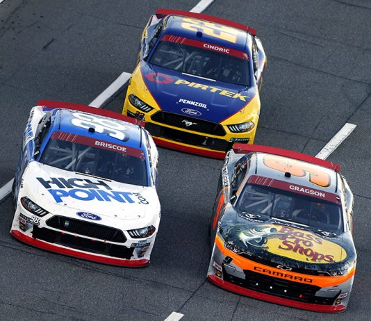 Noah Gragson (9), Chase Briscoe (98) and Austin Cindric battle for position Saturday at Martinsville Speedway. (Brian Lawdermilk/Getty Images Photo)