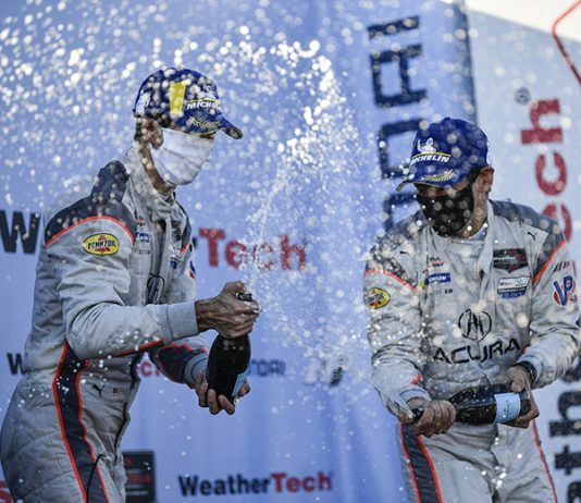 Ricky Taylor and Helio Castroneves celebrate after their victory in the Hyundai Monterey Sports Car Championship at WeatherTech Raceway Laguna Seca. (IMSA Photo)
