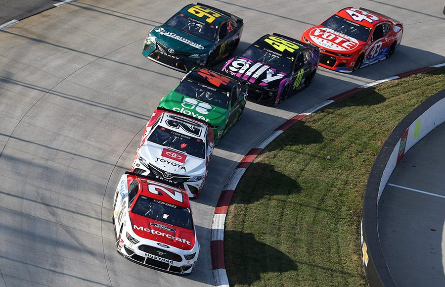 Matt DiBenedetto (21) leads a pack of cars during Sunday's Xfinity 500 at Martinsville Speedway. (Brian Lawdermilk/Getty Images Photo)