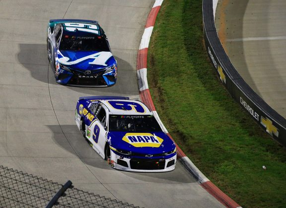 Chase Elliott (9) leads Martin Truex Jr. during Sunday's Xfinity 500 at Martinsville Speedway. (HHP/Jim Fluharty Photo)