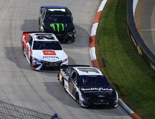 Aric Almirola (10), Erik Jones (20) and Kurt Busch battle for position during Sunday's Xfinity 500 at Martinsville Speedway. (HHP/Jim Fluharty Photo)