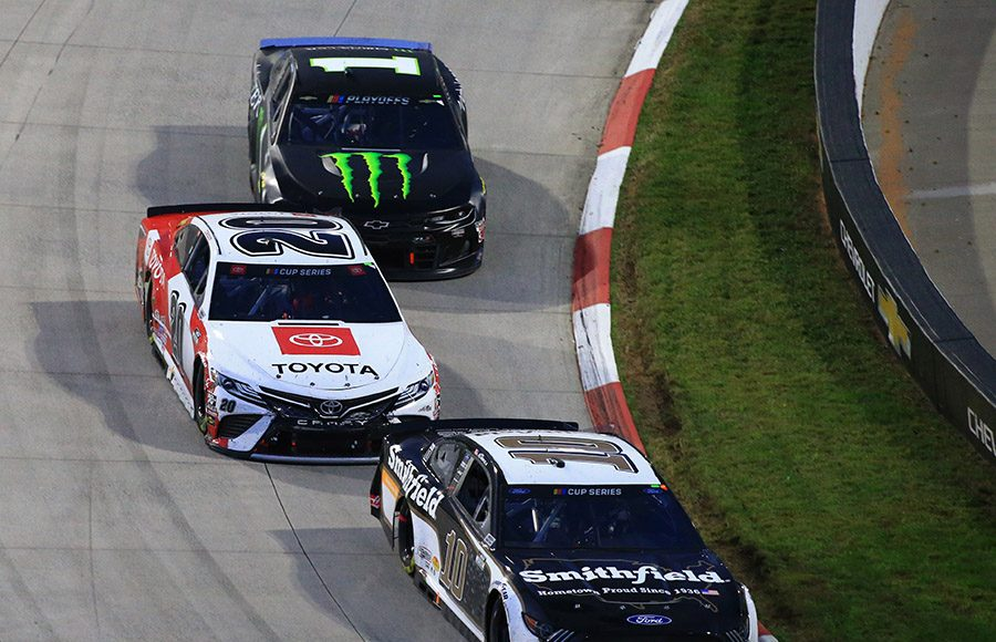 Aric Almirola (10), Erik Jones (20) and Kurt Busch battle for position during Sunday's Xfinity 500 at Martinsville Speedway. (HHP/Jim Fluharty Photo)