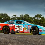 The race car Marcos Ambrose drove to his first NASCAR victory is going up for auction in Australia.