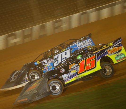 Donny Schatz (15) races under Tim McCreadie during Wednesday's World of Outlaws Late Model Series feature at The Dirt Track at Charlotte. (Adam Fenwick Photo)