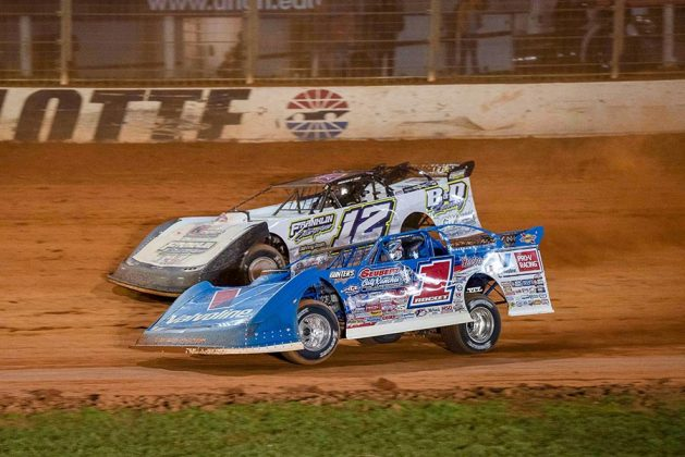 Brandon Sheppard (1) races under Ashton Winger during Thursday's World of Outlaws Morton Buildings Late Model Series feature at The Dirt Track at Charlotte. (Shawn Cooper Photo)