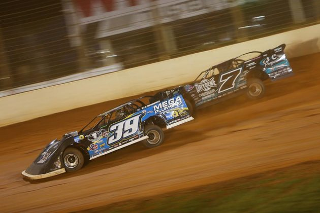 Tim McCreadie (39) takes the lead from Ricky Weiss during Thursday's World of Outlaws Morton Buildings Late Model Series event at The Dirt Track at Charlotte. (Adam Fenwick Photo)