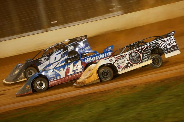 Scott Bloomquist (0), Josh Richards (14) and Kyle Larson battle for position during Thursday's World of Outlaws Morton Buildings Late Model Series event at The Dirt Track at Charlotte. (Adam Fenwick Photo)