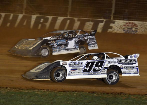 Boom Briggs (99) battles Ryan King during Thursday's World of Outlaws Morton Buildings Late Model Series event at The Dirt Track at Charlotte. (Frank Smith Photo)