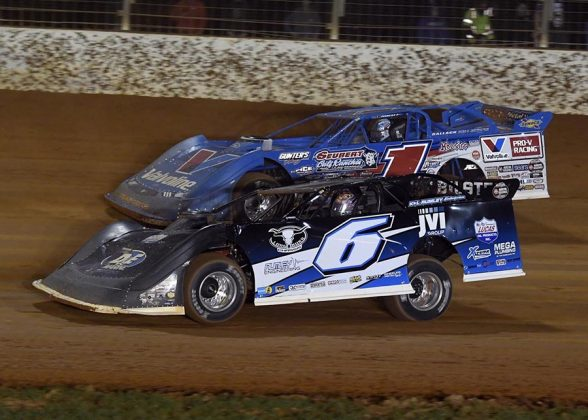 Kyle Larson (6) races under Brandon Sheppard during Thursday's World of Outlaws Morton Buildings Late Model Series event at The Dirt Track at Charlotte. (Frank Smith Photo)