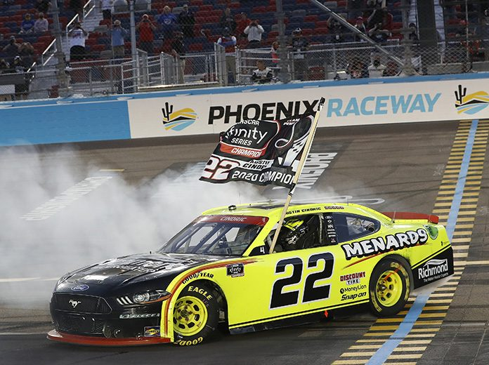 Austin Cindric celebrates after winning the NASCAR Xfinity Series championship Saturday at Phoenix Raceway. (HHP/Harold Hinson Photo)