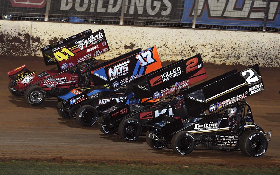 The field for Friday's World of Outlaws NOS Energy Drink Sprint Car Series event prepares to go racing at The Dirt Track at Charlotte. (Frank Smith Photo)