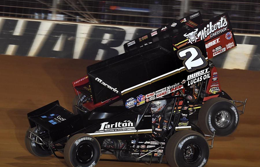 Carson Macedo (2) battles David Gravel for the lead early in Friday's World of Outlaws NOS Energy Drink Sprint Car Series feature at The Dirt Track at Charlotte. (Frank Smith Photo)