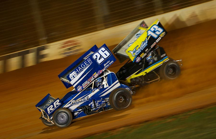 Cory Eliason (26) battles Justin Peck during Friday's World of Outlaws NOS Energy Drink Sprint Car Series event at The Dirt Track at Charlotte. (Adam Fenwick Photo)