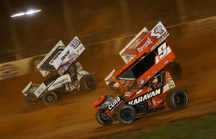 James McFadden (9), Logan Schuchart (1s) and Spencer Bayston battle for position during Friday's World of Outlaws NOS Energy Drink Sprint Car Series event at The Dirt Track at Charlotte. (Adam Fenwick Photo)