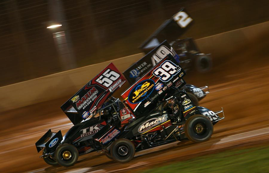 Anthony Macri (39), Hunter Schuerenberg (55), Shawn Dancer (49) and Bill Balog battle during the B-Main as part of Friday's World of Outlaws NOS Energy Drink Sprint Car Series event at The Dirt Track at Charlotte. (Adam Fenwick Photo)