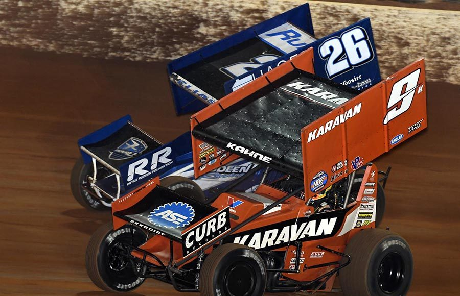 Kasey Kahne (9) races under Cory Eliason during Friday's World of Outlaws NOS Energy Drink Sprint Car Series feature at The Dirt Track at Charlotte. (Frank Smith Photo)