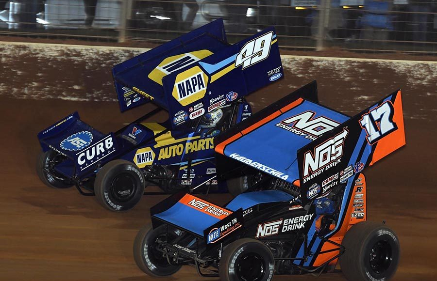 Sheldon Haudenschild (17) races under Brad Sweet during Friday's World of Outlaws NOS Energy Drink Sprint Car Series feature at The Dirt Track at Charlotte. (Frank Smith Photo)