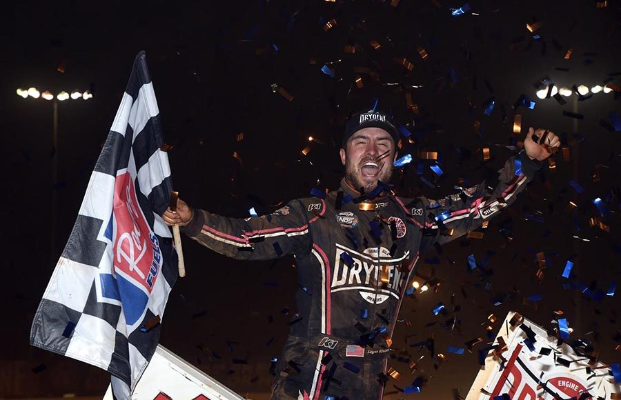 Logan Schuchart celebrates after winning Saturday's World of Outlaws NOS Energy Drink Sprint Car Series finale at The Dirt Track at Charlotte. (Frank Smith Photo)