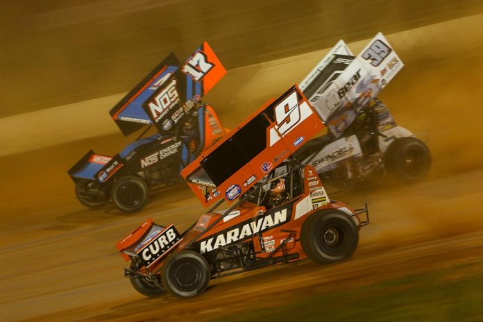 James McFadden (9), Sheldon Haudenschild (17) and Spencer Bayston battle for position during Saturday's World of Outlaws NOS Energy Drink Sprint Car Series event at The Dirt Track at Charlotte. (Adam Fenwick Photo)