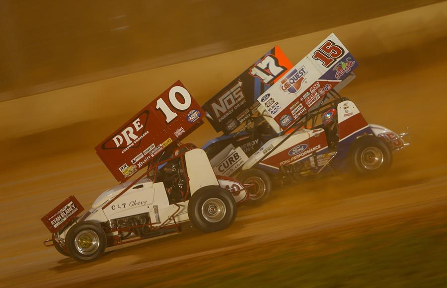 Dave Blaney (10), Sheldon Haudenschild (17) and Donny Schatz race three-wide during Saturday's World of Outlaws NOS Energy Drink Sprint Car Series event at The Dirt Track at Charlotte. (Adam Fenwick Photo)
