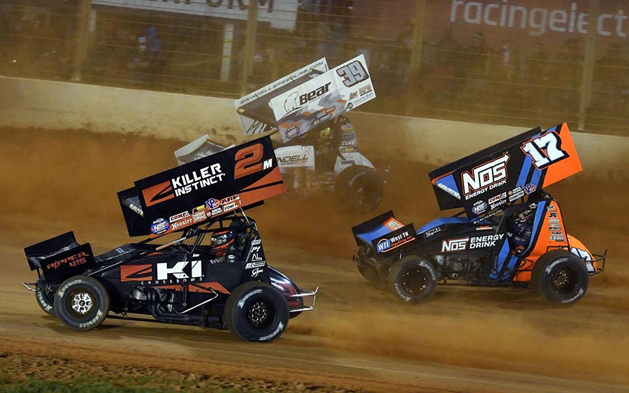 Kerry Madsen (2), Sheldon Haudenschild (17) and Spencer Bayston race for position during Saturday's World of Outlaws NOS Energy Drink Sprint Car Series event at The Dirt Track at Charlotte. (Frank Smith Photo)