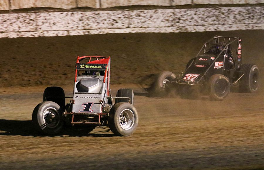 Damion Gardner (1) slides ahead of Matt Mitchell during the USAC/CRA and USAC Southwest sprint car portion of Friday's Western World Championship opener at Arizona Speedway. (Ivan Veldhuizen Photo)