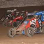 Justin Grant (5), Daison Pursley (9) and Brenham Crouch battle three-wide during the USAC NOS Energy Drink National Midget Series portion of Friday's Western World Championship preliminary event at Arizona Speedway. Ivan Veldhuizen Photo)