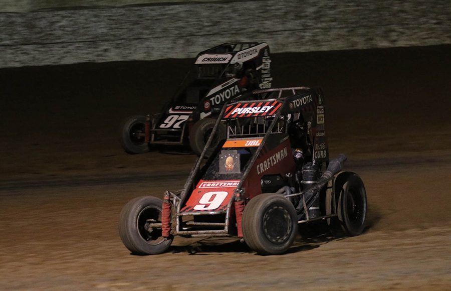 Daison Pursley (9) races under Brenham Crouch during the USAC NOS Energy Drink National Midget Series portion of Friday's Western World Championship preliminary event at Arizona Speedway. Ivan Veldhuizen Photo)