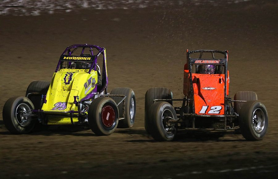 Stevie Sussex (12) races under Chris Muraoka during the USAC/CRA and USAC Southwest sprint car portion of Friday's Western World Championship opener at Arizona Speedway. (Ivan Veldhuizen Photo)