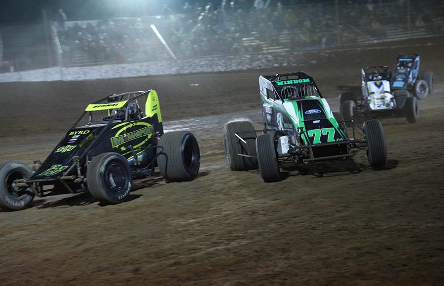 Chris Windom (77) tries to slide under Ryan Bernal during the USAC/CRA and USAC Southwest sprint car portion of Friday's Western World Championship opener at Arizona Speedway. (Ivan Veldhuizen Photo)