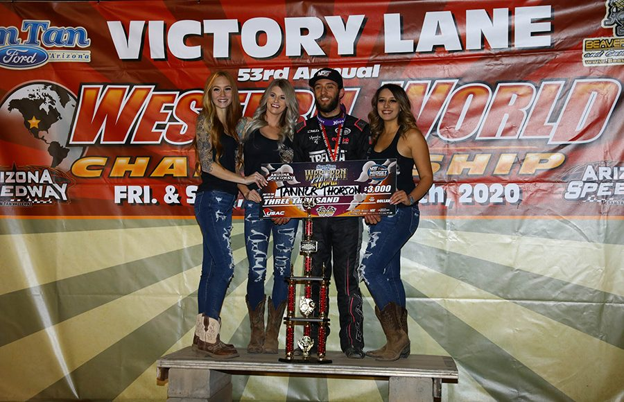 Tanner Thorson poses in victory lane after winning the USAC NOS Energy Drink National Midget Series portion of Friday's Western World Championship preliminary event at Arizona Speedway. (Ivan Veldhuizen Photo)