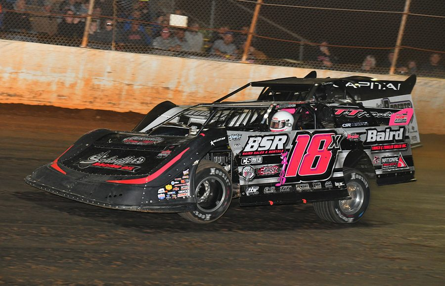 Michael Page (18) holds off Randy Weaver in a battle for the race lead during Saturday's Fall Nationals Series race at Boyd's Speedway. (Michael Moats Photo)
