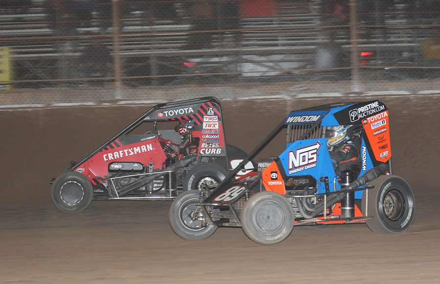 Chris Windom (89) battles Daison Pursley during Saturday's USAC NOS Energy Drink National Midget Series feature at Arizona Speedway. (Ivan Veldhuizen Photo)