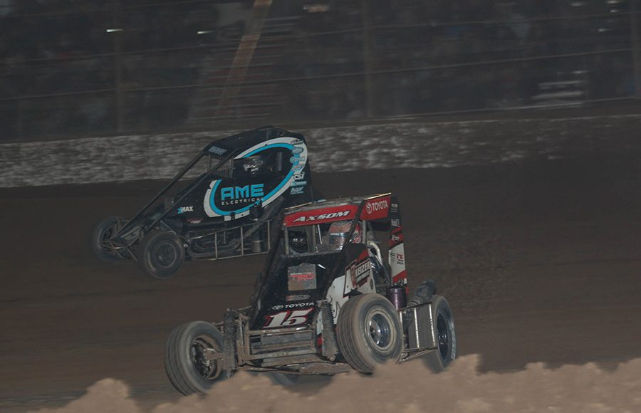 Emerson Axsom (15) battles Logan Seavey during Saturday's USAC NOS Energy Drink National Midget Series feature at Arizona Speedway. (Ivan Veldhuizen Photo)