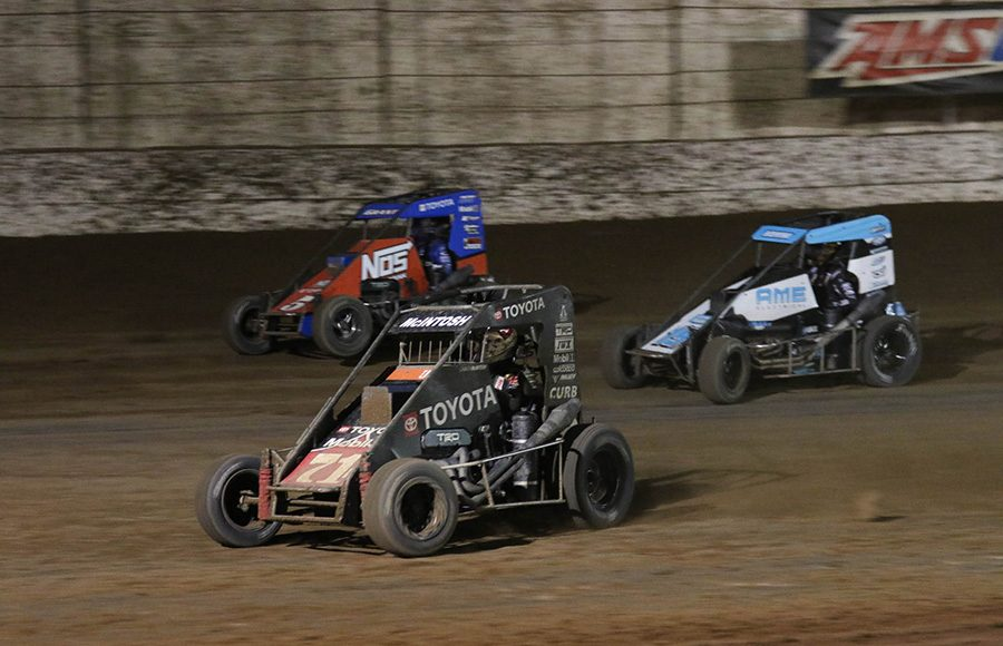 Buddy Kofoid (67) races under Justin Grant (5) and Spencer Bayston during Saturday's USAC NOS Energy Drink National Midget Series feature at Arizona Speedway. (Ivan Veldhuizen Photo)