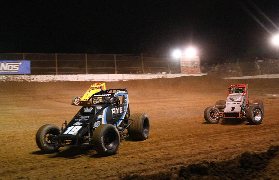 Justin Grant (19) leads Damion Gardner (1) on the bottom of the track during the USAC/CRA and USAC Southwest sprint car portion of Friday's Western World Championship opener at Arizona Speedway. (Ivan Veldhuizen Photo)