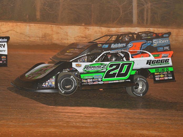 Jimmy Owens (20) battles Dustin Linville on his way to victory Saturday at 411 Motor Speedway. (Michael Moats Photo)