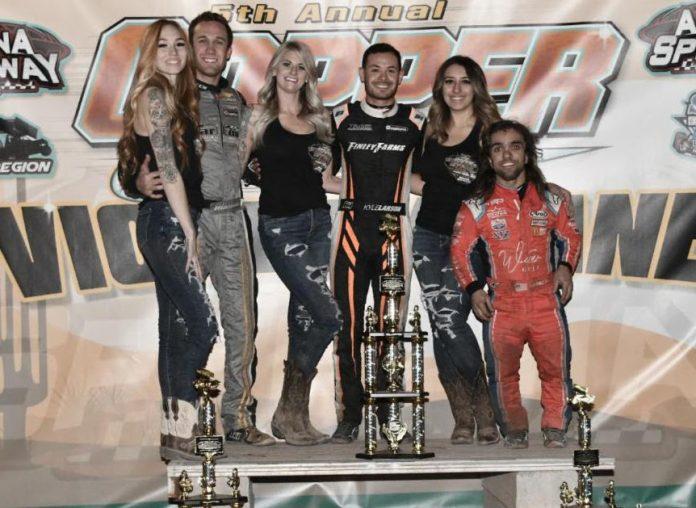 Kyle Larson (center) shares the podium with Carson Macedo and Rico Abreu. (Ben Thrasher photo)