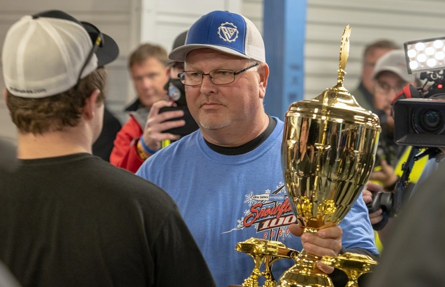 Technical Inspector Ricky Brooks hands the Snowflake 100 trophy to race winner Jake Johnson Saturday at Five Flags Speedway. (Jason Reasin Photo)