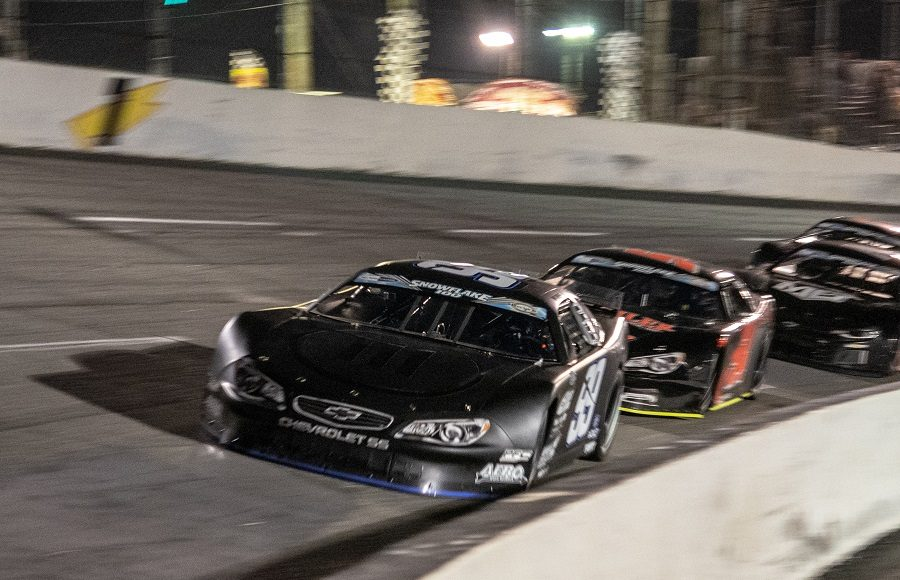 Justin Marks (99) leads a group of cars during Saturday's Snowflake 100 at Five Flags Speedway. (Jason Reasin Photo)