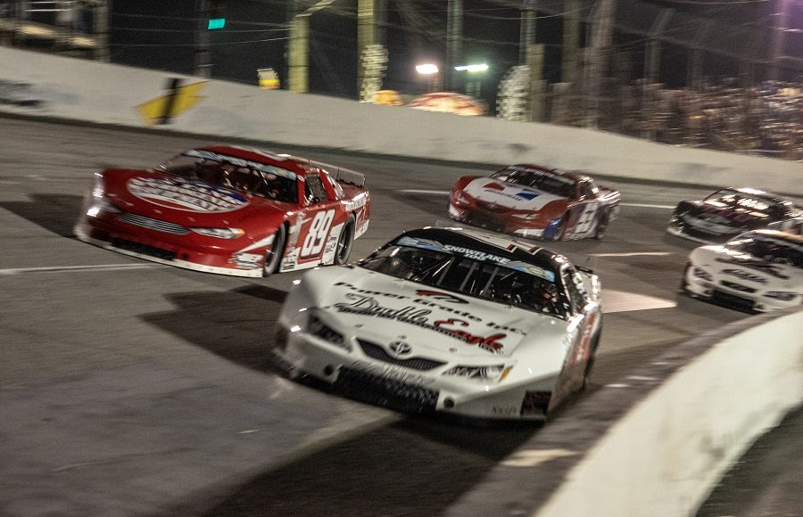Derek Thorn (43) races under Dylan Fetcho during the start of the Snowflake 100 Saturday at Five Flags Speedway. (Jason Reasin Photo)