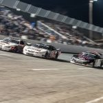 Stephen Nasse (51), Bubba Pollard (26) and Derek Thorn (43) race three-wide for the lead during the Snowflake 100 Saturday at Five Flags Speedway. (Jason Reasin Photo)