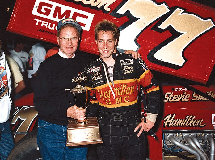 Al Hamilton (left) poses with driver Stevie Smith after one of countless victories during a lengthy career as a team owner.