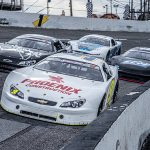Chase Elliott (9) leads a pack of cars through a turn during the Snowball Derby. (Jason Reasin Photo)
