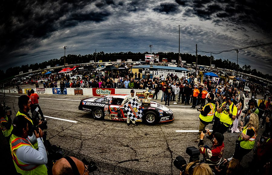 Photographers and fans surround Ty Majeski in victory lane following his victory in Sunday's Snowball Derby. (Jason Reasin Photo)