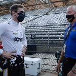 Penske Corp. President Bud Denker, shown here speaking with Josef Newgarden, is optimistic fans will be allowed for the 2021 Indianapolis 500. (IndyCar Photo)