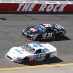 Ben Rhodes (41) and Brandon Jones (33) battle during a late model stock car race at Rockingham Speedway in 2013. The planned return to racing at Rockingham Speedway has been postponed from March 6 to Oct. 30. (Adam Fenwick Photo)