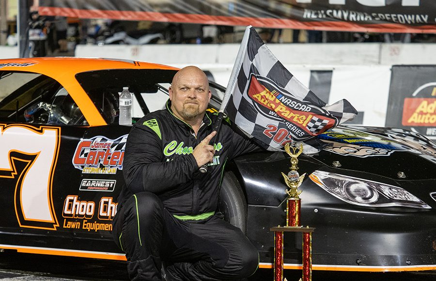 Jeff Scofield poses in victory lane after winning the super late model portion of the Red Eye 50/50 at New Smyrna Speedway on Saturday night. (Jason Reasin Photo)