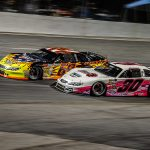 Jesse Dutilly (30) battles Michael Hinde during Saturday's Red Eye 50/50 super late model feature at New Smyrna Speedway. (Jason Reasin Photo)